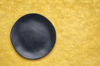 black plate on textured paper