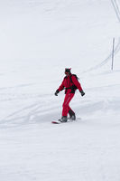 Snowboarder on snowy ski slope
