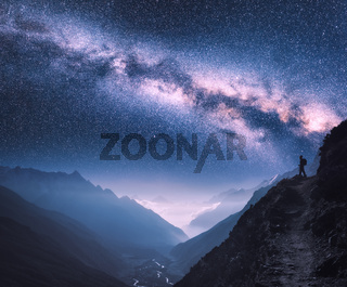 Space with Milky Way, girl and mountains in Nepal