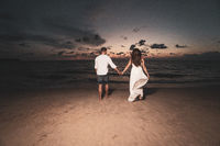 Romantic couple on th beach during sunset