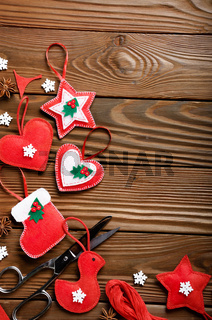 Handmade rustic Christmas tree decorations with scissors and anise on wooden table