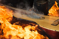 Guitar in flame on bonfire