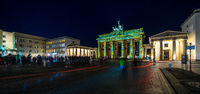 Pariser Platz and Brandenburg Gate in brightly colored illuminations. Festival of lights 2018.