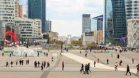 Paris, France, March 31 2017: La Defense - modern business and financial district in Paris with high rise buildings. People in the central square