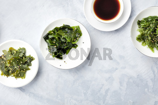 Various seaweed, sea vegetables, shot from the top with copy space. Superfoods background or a recipe design template