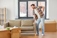 man having back ache moving to new home