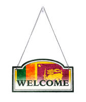 Sri Lanka welcomes you! Old metal sign isolated