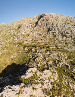 Panoramic landscape. Hairpin turn road between rocky mountains. Way to Sa Calobra beach, Mallorca, Balearic Islands