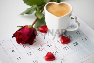 close up of calendar, hearts, coffee and red rose