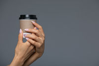Take Away White Paper Hot Coffee Cup With Right Hand Holding.