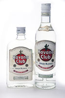 """different sizes and shapes bottles with white rum """"Havana Club"""", produced in Cuba"""