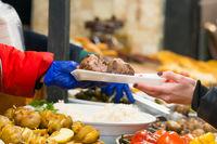 People serving street food