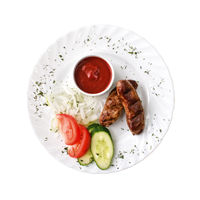 Grilled sausages and tomato sauce on the plate, isolated on white background. Top view