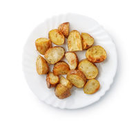 Top view of baked potatoes wedges on plate