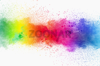 Colorful powder explosion on white background. Pastel color dust particle splashing.