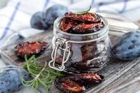 Glass jar with dried spicy plum.