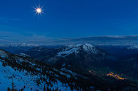 View from the summit of Wendelstein mountain to the Alps at full moon