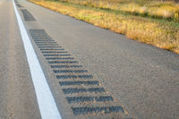 safety rumble strips on a highway shoulder