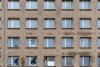 Full frame of broken windows in old building facade