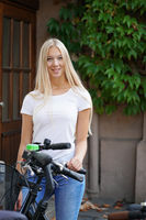 young woman standing outside with bicycles