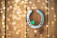 horseshoe with shamrock on wooden background