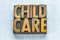 child care text in wood type