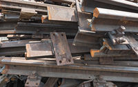 old rusty railroad tracks for scrapping in a warehouse space