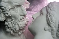 Antique statues of woman and man heads close. Concept of style, vintage, love.