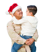 Hispanic Male Soldier Wearing Santa Cap Holding Mixed Race Son Isolated on a White Background