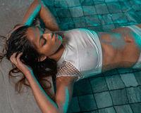 Beautiful woman in the outdoor swimming pool