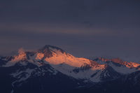 Last sunlight of the day touching the peak of Mount Hoch Ducan, Canton of Grisons, Switzerland.