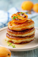 Pancakes with apricot jam and thyme for breakfast.