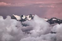 Mountain peaks above moving clouds