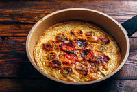 Frittata with chorizo, tomatoes and chili peppers.