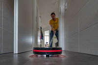 A modern vacuum robot in cleaning action.