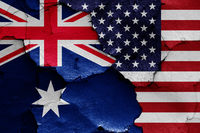 flags of Australia and USA painted on cracked wall