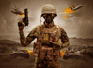 Armed soldier standing in the middle of a war