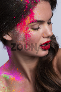 Woman face with colorful makeup