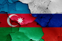 flags of Azerbaijan and Russia painted on cracked wall