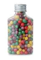 Small bottle full of colorful drops candy