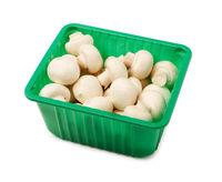 Fresh champignon mushrooms in the packaging box