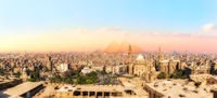 Sights of Cairo panorama: the Mosque-Madrassa of Sultan Hassan, the city view and the Pyramids