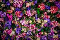Background artificial bright flowers. Bright floral background.