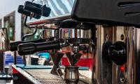Coffee machine in coffee house producing espresso