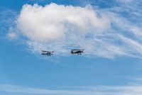 Formation flying of two old biplane aircrafts during air show