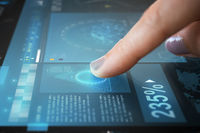 finger on touch screen with virtual data