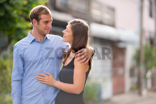 Young couple together in the streets outdoors