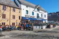 Old restaurant Skarven in Tromso, Norway. One early spring day with many visitors.