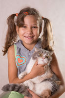 Cute little girl smiling looking with two sloppy pigtails