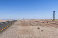 Electricity track in the desert in a straight line to the horizon, Namibia, Africa.